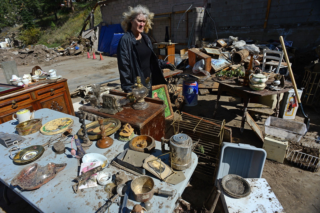 . GLEN HAVEN, CO - OCTOBER 8: Glen Haven Inn owner Sheila Sellers looks at what remains of some of the thousands of antiques that filled the inside of her historic Glen Haven Inn in Glen Haven, CO on October 8, 2013.  (Photo By Helen H. Richardson/ The Denver Post)
