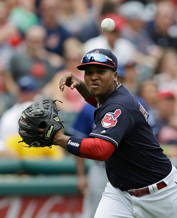 . Cleveland Indians\' Jose Ramirez bobbles a ball hit by Texas Rangers\' Adrian Beltre in the seventh inning of a baseball game, Thursday, June 29, 2017, in Cleveland. Beltre was safe at first base. The Indians won 5-1. (AP Photo/Tony Dejak)