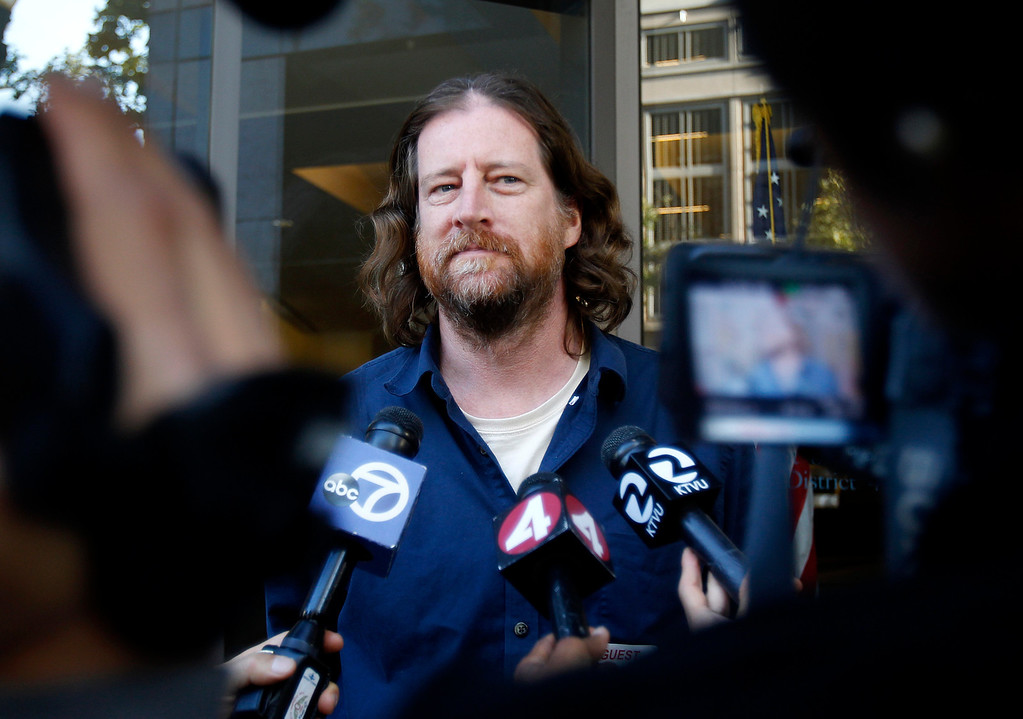 . Chris Finn, a BART train operator and recording secretary for the local Amalgamated Transit Union, speaks to the media outside of the Caltrans offices in downtown Oakland, Calif. on Sunday, Aug. 11, 2013.  (Nhat V. Meyer/Bay Area News Group)