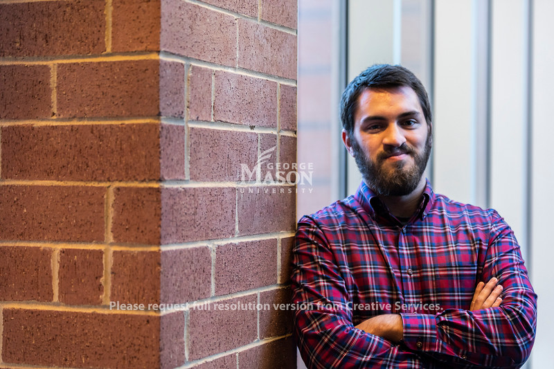 Alexei Sothoron has two undergraduate degrees from Mason, including one with a double major. Now he's going for his master's. Photo by Lathan Goumas/Strategic Communications