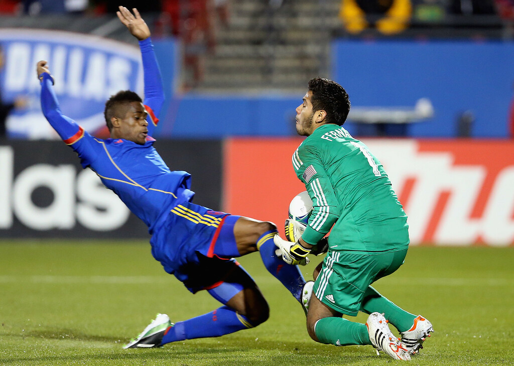 . FRISCO, TX - MARCH 02:  Raul Fernandez #1 of FC Dallas makes a save against Deshorn Brown #26 of the Colorado Rapids at FC Dallas Stadium on March 2, 2013 in Frisco, Texas.  (Photo by Ronald Martinez/Getty Images)