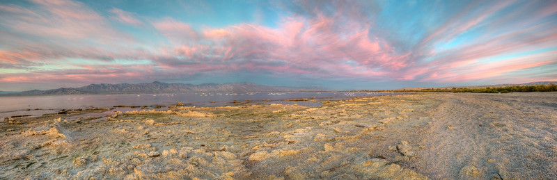 The clouds start to catch the color of the sunrise at the Salton Sea State park.