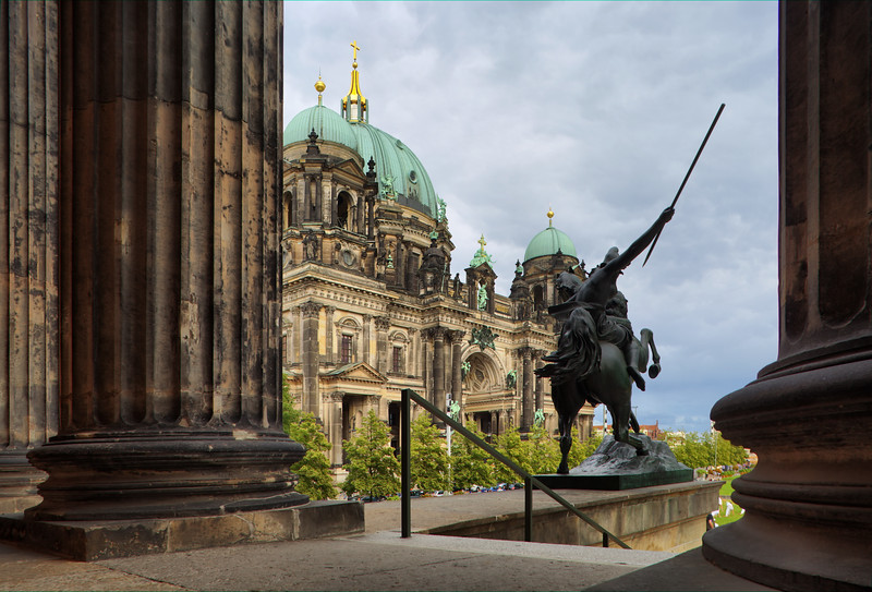 The Berliner Dom (Cathedral) as seen from behind the columns of the Altes Museum portico, Berlin, Germany