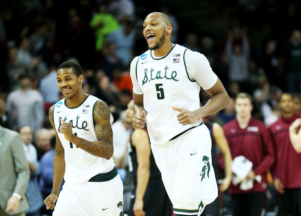 . SPOKANE, WA - MARCH 22:  Adreian Payne #5 and Keith Appling #11 of the Michigan State Spartans celebrate their 80 to 73 win over the Harvard Crimson during the Third Round of the 2014 NCAA Basketball Tournament at Spokane Veterans Memorial Arena on March 22, 2014 in Spokane, Washington.  (Photo by Stephen Dunn/Getty Images)