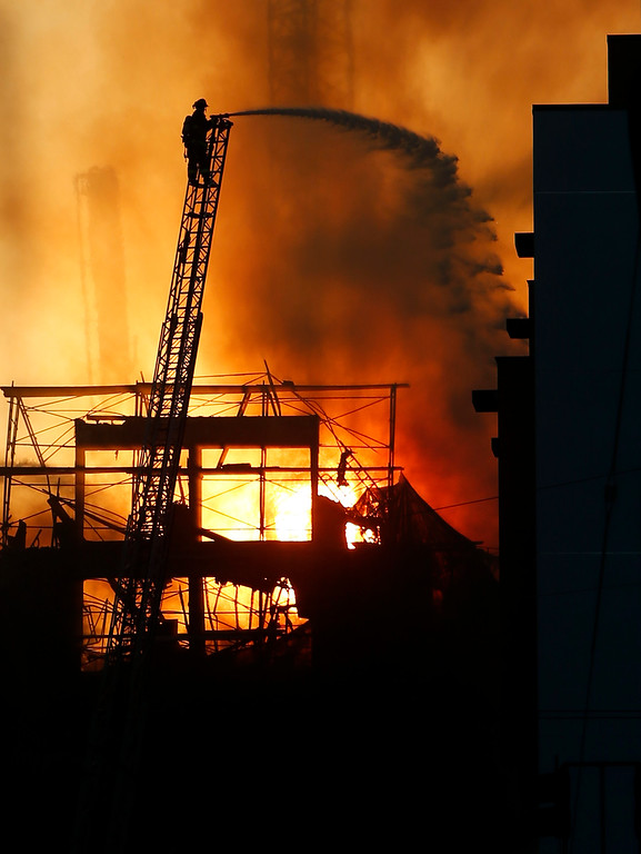 . Firefighters battle a multi-story residential blaze in a building under construction in the Mission Bay neighborhood of San Francisco, Calif., Tuesday evening March 11, 2014. (Karl Mondon/Bay Area News Group)