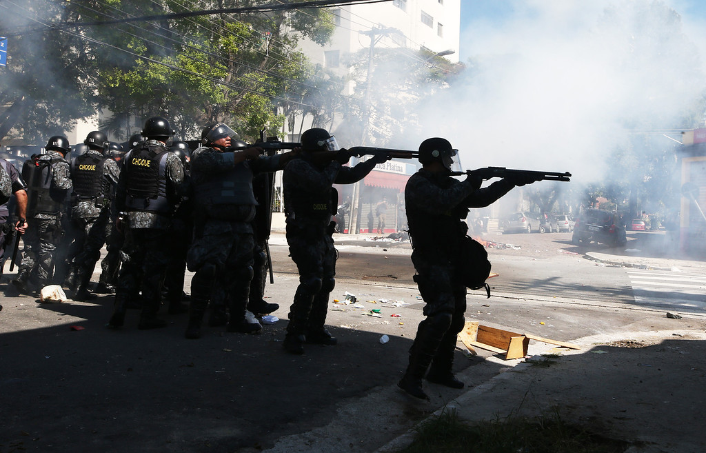 . Police fire non-lethal rounds at protestors during a World Cup protest outside Carrao Metro Station on June 12, 2014 in Sao Paulo, Brazil.  (Photo by Mario Tama/Getty Images)