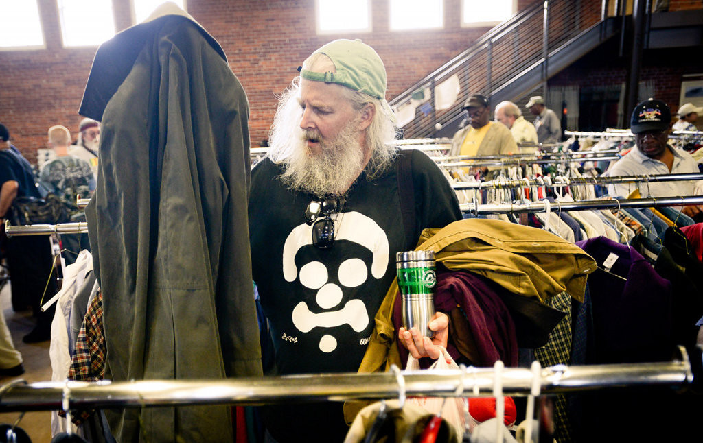 . Army veteran Clint Hubbs of St. Paul, who served in the Vietnam War as a gunner in the 3rd Armored Division in 1970, selects from racks of free clothing. (Pioneer Press: Ben Garvin)