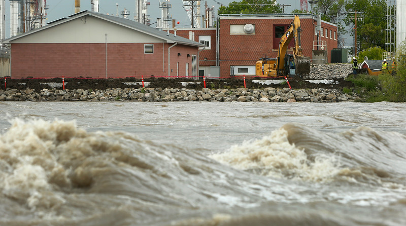 Crew members work to construct a dike around the water plant in Laurel on May 23, 2018. Heavy rainfall is causing major flooding throughout Yellowstone County, prompting the city of Laurel to declare a state of emergency Tuesday afternoon.