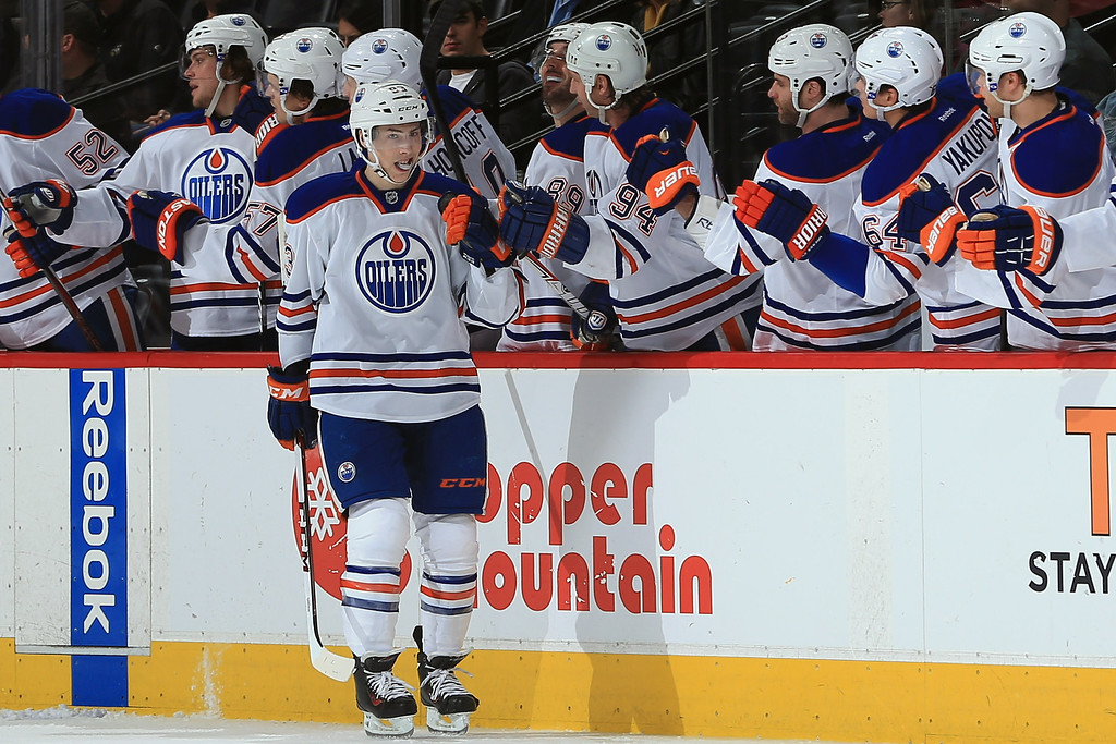 . DENVER, CO - APRIL 19:  Ryan Nugent-Hopkins #93 of the Edmonton Oilers celebrates his second period goal against the Colorado Avalanche to give the Oilers a 3-1 lead at the Pepsi Center on April 19, 2013 in Denver, Colorado.  (Photo by Doug Pensinger/Getty Images)
