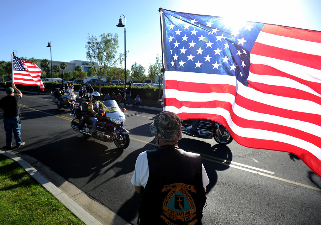 """. Hundreds of \""""Run For The Wall\"""" motorcycle riders gathered at Victoria Gardens in Rancho Cucamonga, Ca., Wednesday morning to begin their the two week journey across the United States, May 14, 2014. Groups of riders will meet with other groups along the way, ending in Washington D.C. at the Vietnam Memorial Wall. The mission is promote healing among all veterans and their families from all wars, and to support our military personnel all over the world. (Photo by John Valenzuela/Inland Valley Daily Bulletin)"""