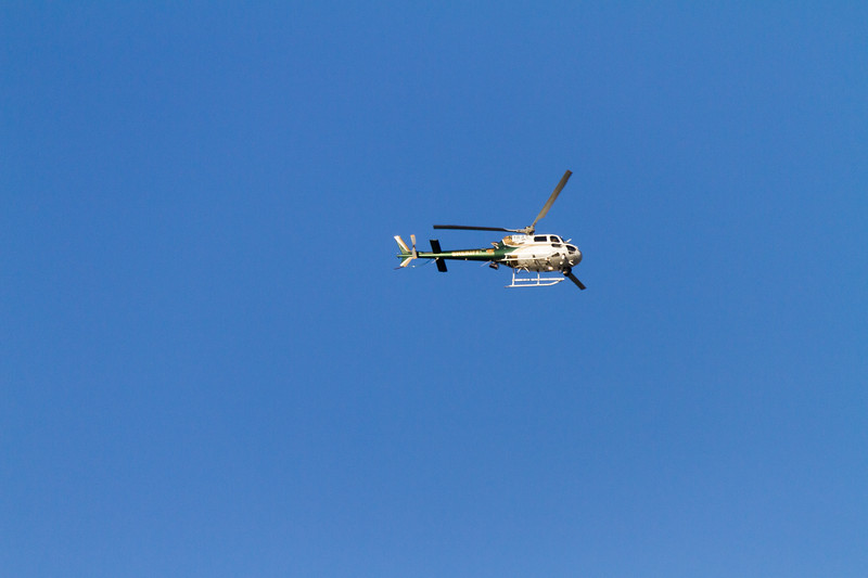 Helicopter flying at blue sky - USA - California
