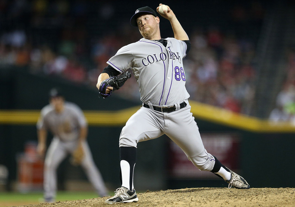 . Relief pitcher Josh Outman #88 of the Colorado Rockies pitches against the Arizona Diamondbacks during the MLB game at Chase Field on July 7, 2013 in Phoenix, Arizona.  (Photo by Christian Petersen/Getty Images)