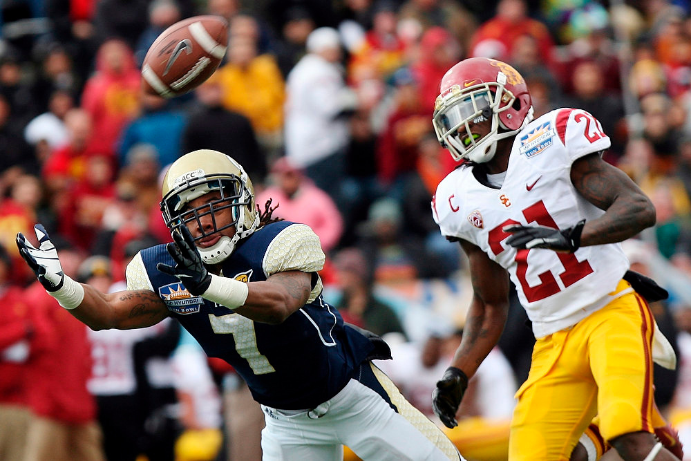 Description of . Georgia Tech's B.J. Bostic (7) dives for a pass while defended by Southern California's Nickell Robey during the Sun Bowl NCAA college football game, Monday, Dec. 31, 2012, in El Paso, Texas. (AP Photo/The El Paso Times, Mark Lambie)