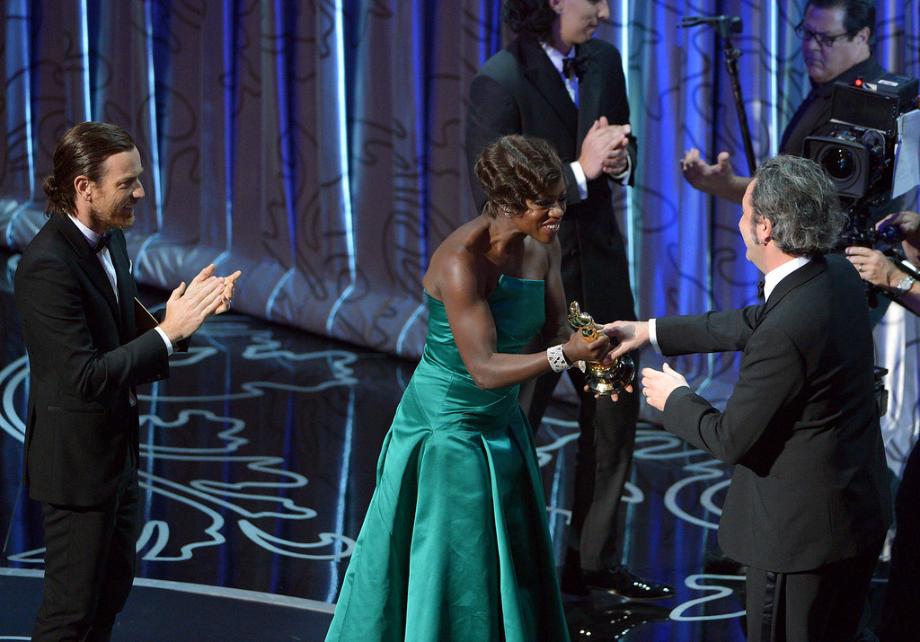 . Presenters Ewan McGregor, left, and Viola Davis present Paolo Sorrentino with the award for best foreign language film of the year for ìThe Great Beautyî during the Oscars at the Dolby Theatre on Sunday, March 2, 2014, in Los Angeles.  (Photo by John Shearer/Invision/AP)