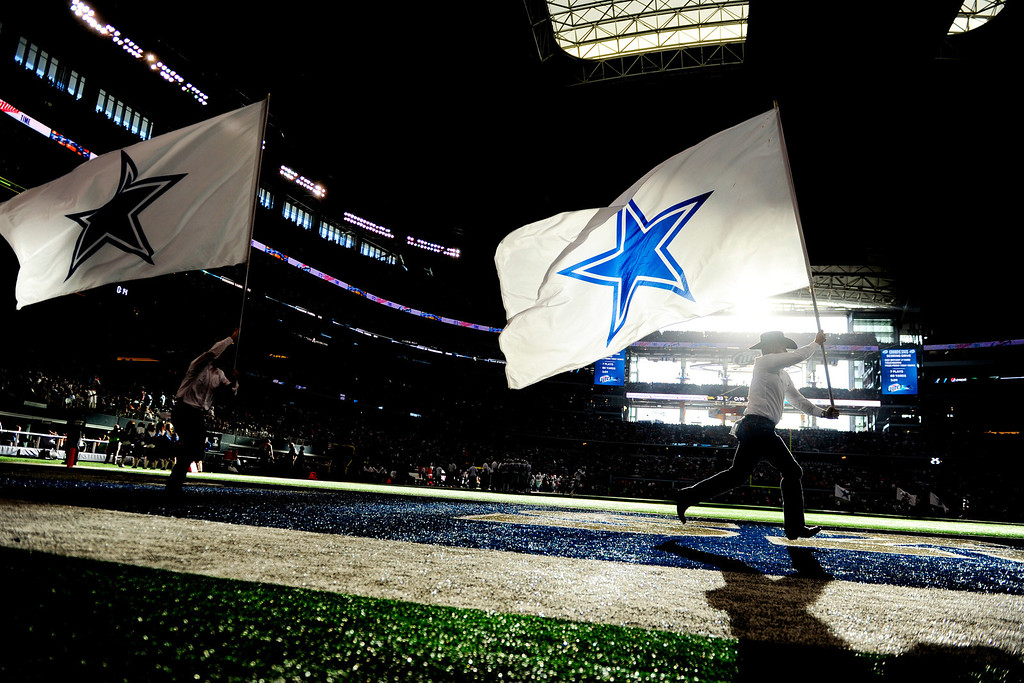 . ARLINGTON, TX - OCTOBER 6: The Dallas Cowboys flag crew waives the team banner after scoring a touchdown against the Denver Broncos during the second half of the Broncos\' 51-48 win at AT&T Stadium. The Denver Broncos visit the Dallas Cowboys. (Photo by AAron Ontiveroz/The Denver Post)