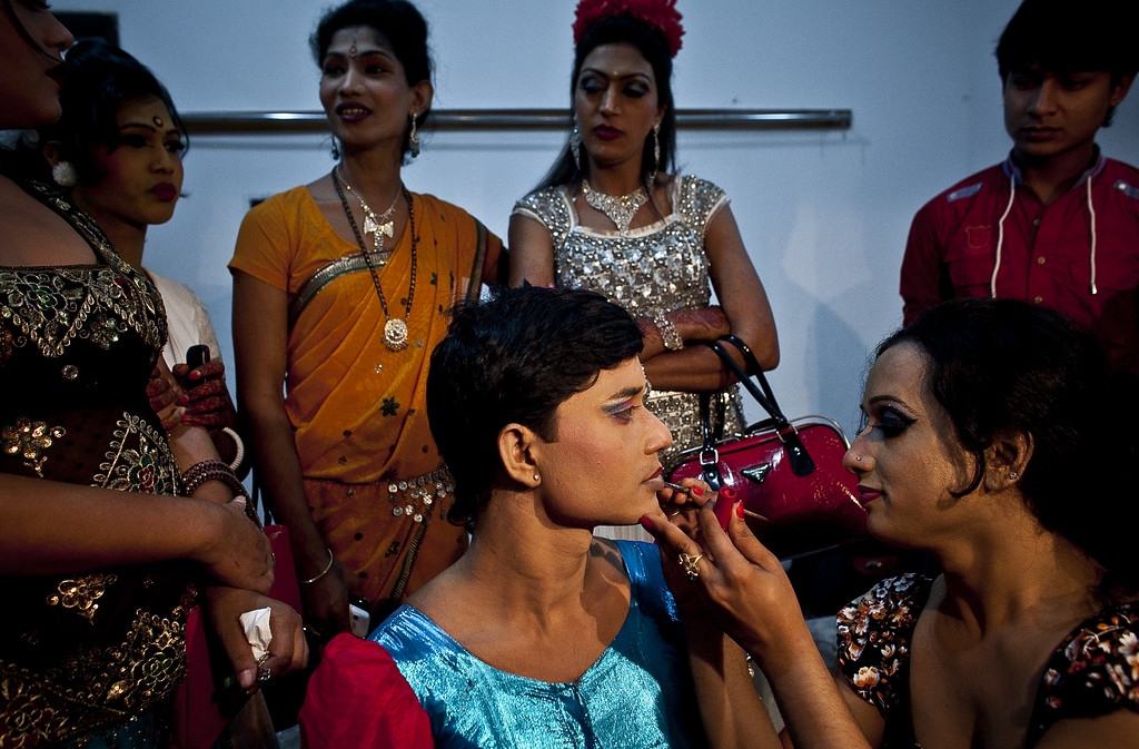 . Hijras, or transgenders,  get ready backstage before the Hijra talent show, part of the first ever event called Hijra Pride 2014, on November 10, 2014 in Dhaka, Bangladesh.  In 2013 Bangladesh officially recognized Hijras as a third gender, though homosexuality still remains illegal. Despite these strides Hijras continue to face violence and harassment as part of their daily life in Bangladesh. (Photo by Allison Joyce/Getty Images)