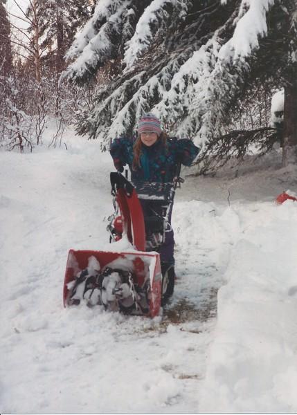 Devon with snowblower for ice rink.jpeg