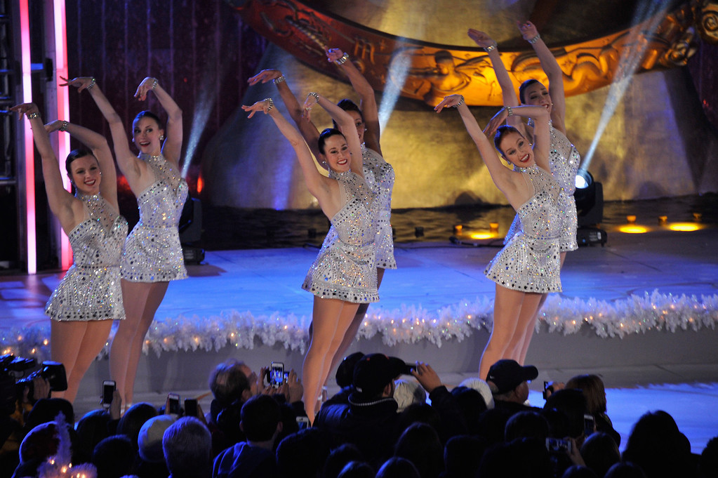 """. Members of the musical \""""Rockettes\"""" perform during 81st Annual Rockefeller Center Christmas Tree Lighting Ceremony at Rockefeller Center on December 4, 2013 in New York City.  (Photo by Stephen Lovekin/Getty Images)"""