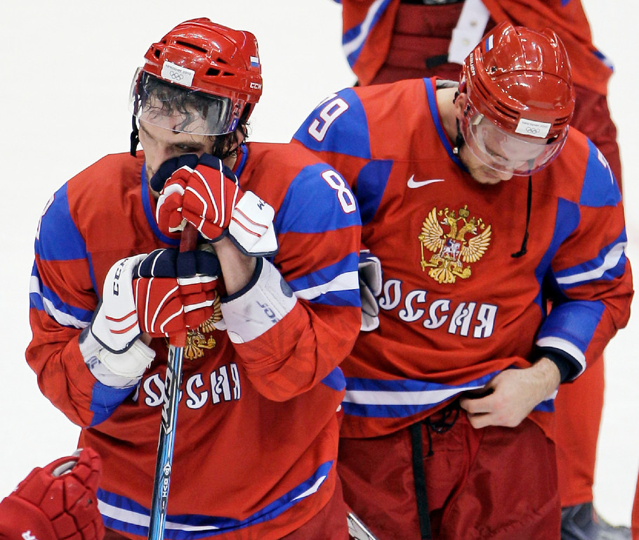 . Russia\'s Alexander Ovechkin (8) and Andrei Markov (79) react after a men\'s quarterfinal round ice hockey game against Canada at the Vancouver 2010 Olympics in Vancouver, British Columbia, Wednesday, Feb. 24, 2010. Canada won 7-3. (AP Photo/Matt Slocum)