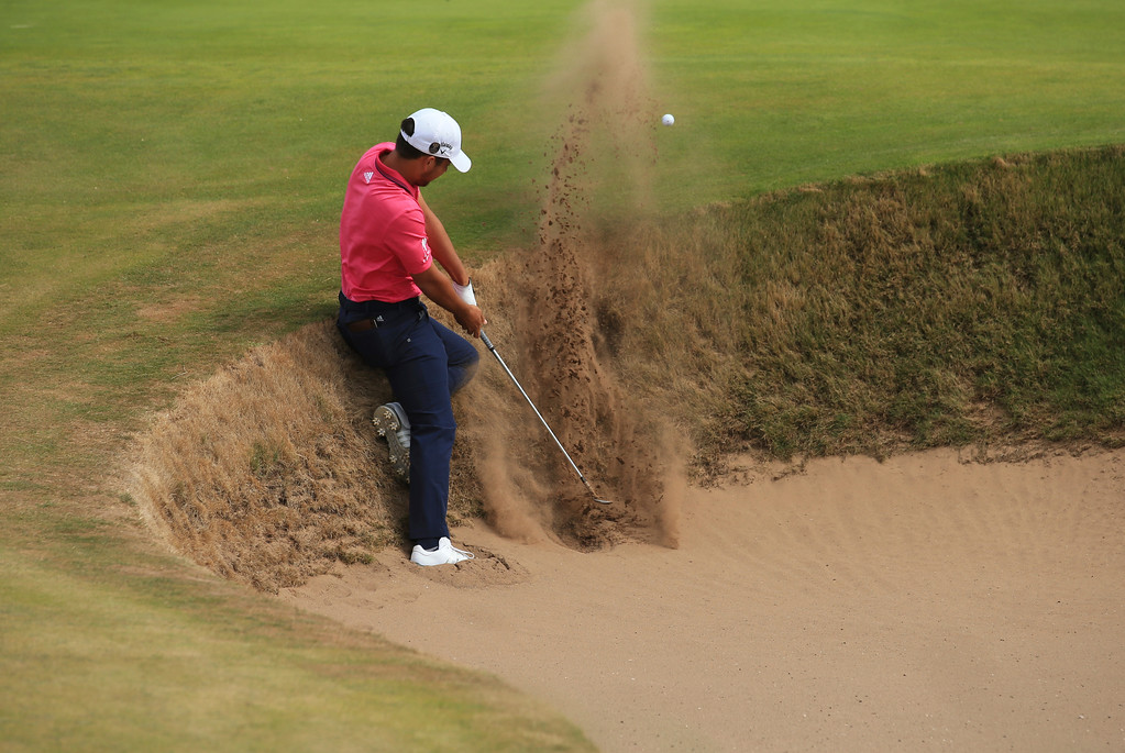 . Xander Schauffele of the US plays out of a bunker on the 5th hole during the final round of the British Open Golf Championship in Carnoustie, Scotland, Sunday July 22, 2018. (AP Photo/Jon Super)