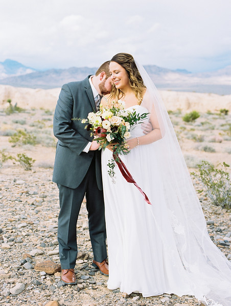 Sweetheart neckline gown with long cathedral veil by Robert Bullock // bridal bouquet with protea, scabiosa, eucalyptus and garden roses - Rooted Willow // Las Vegas desert elopement // Las Vegas Elopement & Intimate Wedding Photographer - Kristen Krehbiel - Kristen Kay Photography