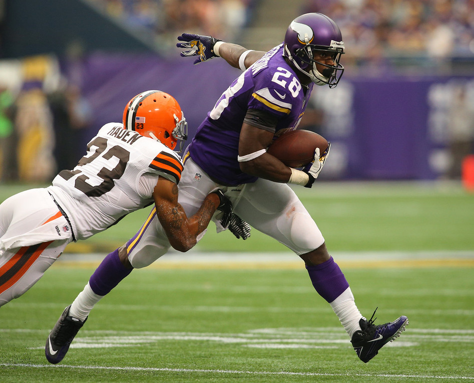 . Joe Haden #23 of the Cleveland Browns attempts the tackle on Adrian Peterson #28 of the Minnesota Vikings on September 22, 2013 at Mall of America Field at the Hubert Humphrey Metrodome in Minneapolis, Minnesota. (Photo by Adam Bettcher/Getty Images)