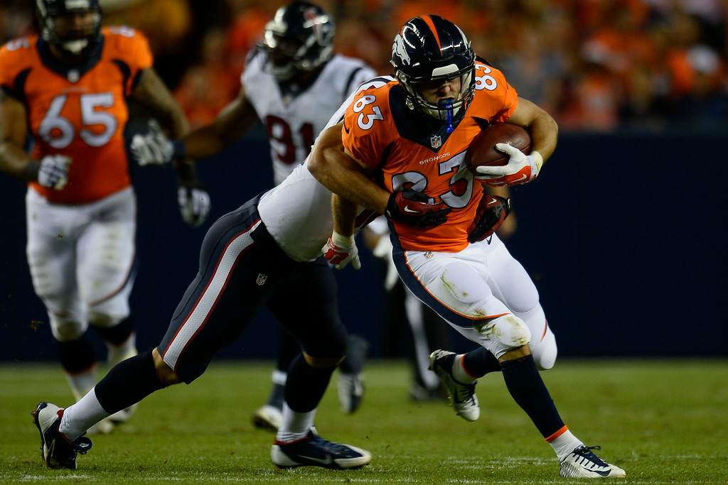 . DENVER, CO - AUGUST 23: Wes Welker (83) of the Denver Broncos carries the ball against the Houston Texans during a preseason football game at Sports Authority Field at Mile High on Saturday, August 23, 2014 in Denver, Colorado.  (Photo by Kent Nishimura/The Denver Post)