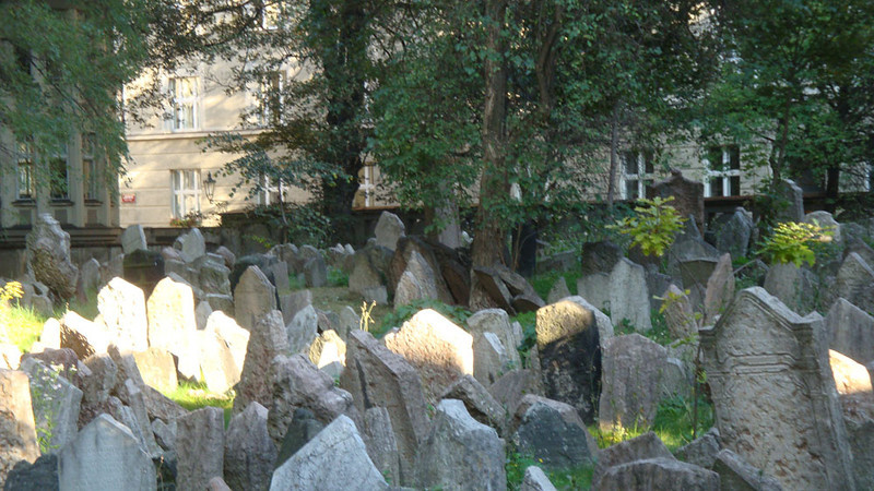 It seems to be a Jewish custom to leave graves undisturbed. Due to limited space in the Jewish cemetery, the bodies are packed 12 deep at one end, creating a growing hill.