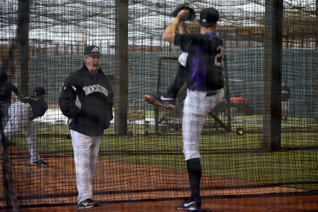 . SCOTTSDALE, AZ. - FEBRUARY 20: Bo McLaughlin, assistant pitching coach wathces Jeff Francis pitch in the batting cages where the  Colorado Rockies had to workout in due to rain during Spring Training  February 20, 2013 in Scottsdale. (Photo By John Leyba/The Denver Post)