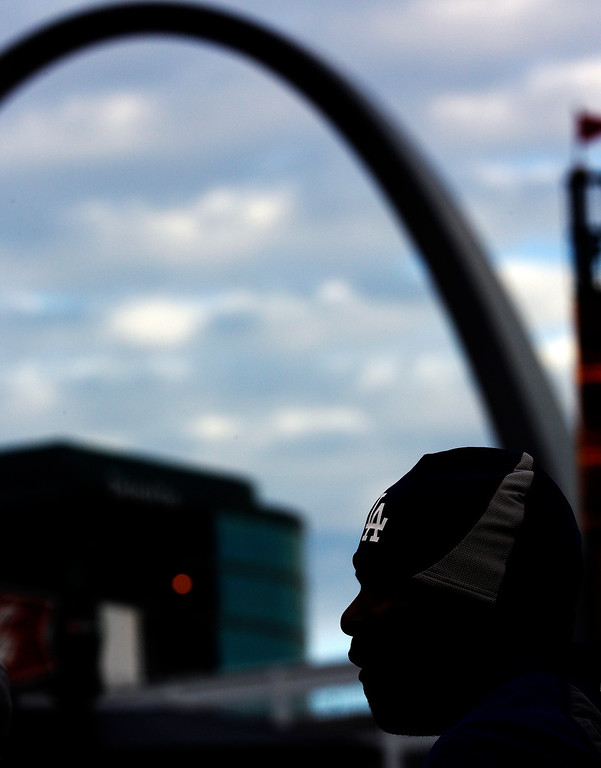 . Los Angeles Dodgers\' Yasiel Puig waits to take batting practice before Game 6 of the National League baseball championship series against the St. Louis Cardinals, Friday, Oct. 18, 2013, in St. Louis. (AP Photo/David J. Phillip)