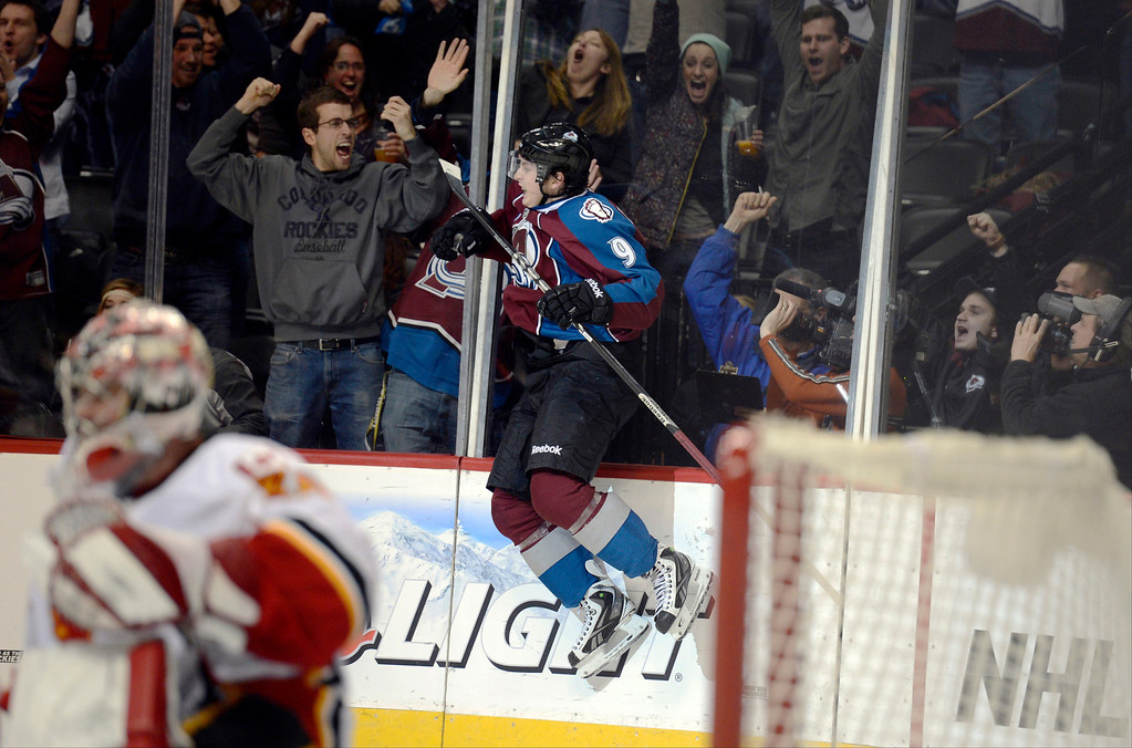 . DENVER, CO. - FEBRUARY 28: Matt Duchene (9) of the Colorado Avalanche jumps into the glass as he celebrates his game winning goal in the third period as Joey MacDonald (35) of the Calgary Flames kneels dejected February 28, 2013 at Pepsi Center.(Photo By John Leyba/The Denver Post)
