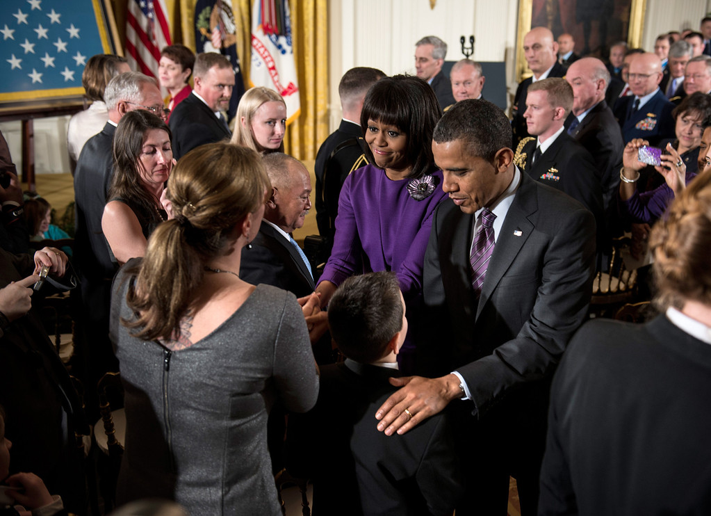 . US President Barack Obama and first lady Michelle Obama greet family members of fallen soldiers after a Medal of Honor ceremony in the East Room of the White House on February 11, 2013 in Washington.   AFP PHOTO/Brendan  SMIALOWSKI/AFP/Getty Images