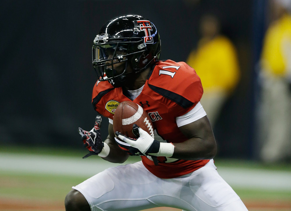 Description of . Jakeem Grant #11 of Texas Tech starts his 99-yard kickoff return for a first quarter touchdown against Minnesota during the Meineke Car Care of Texas Bowl at Reliant Stadium on December 28, 2012 in Houston, Texas.  (Photo by Scott Halleran/Getty Images)
