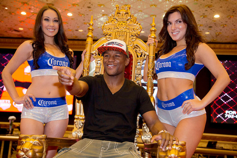 . Floyd Mayweather Jr. poses for photos after arriving at the MGM Grand casino and hotel, Tuesday, May 1, 2012, in Las Vegas. Mayweather will fight Miguel Cotto for the WBC super welterweight title on Saturday. (AP Photo/Julie Jacobson)