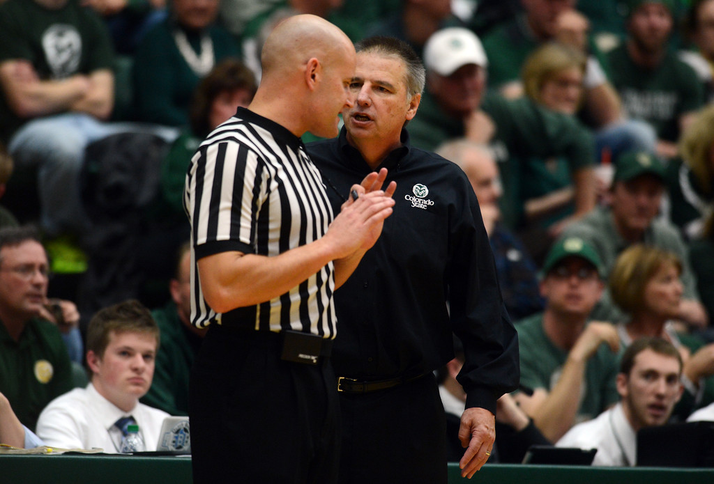 . Fort COLLINS, CO. - FEBRUARY 23: CSU coach Larry Eustachy talks with an official during second half action at Moby Arena in Fort Collin, CO February  24, 2013. The Colorado State Rams mens basketball team lost to the New Mexico Lobos, 82-91. (Photo By Craig F. Walker/The Denver Post)