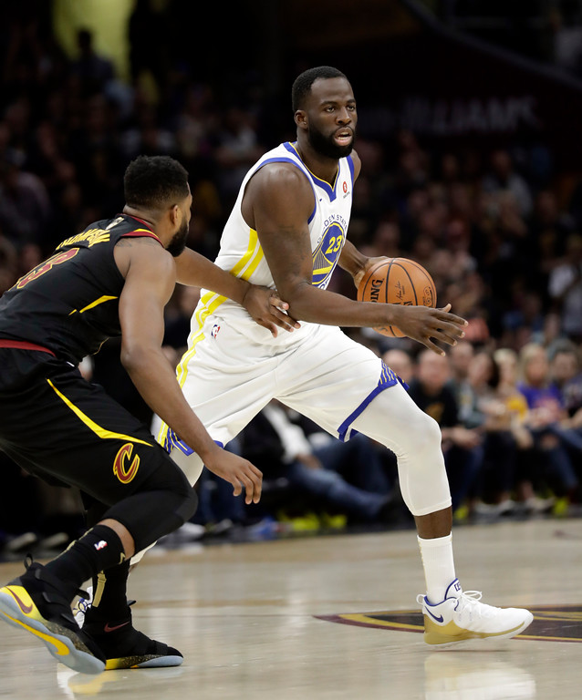 . Golden State Warriors\' Draymond Green is defended by Cleveland Cavaliers\' Tristan Thompson in the first half of Game 4 of basketball\'s NBA Finals, Friday, June 8, 2018, in Cleveland. (AP Photo/Tony Dejak)