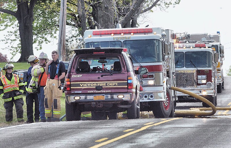 Jack Haley/Messenger Post MediaFire trucks from Fishers, Victor and Farmington were staged on Blazey Road. Grass trucks were also used in assisting with the fire suppression.
