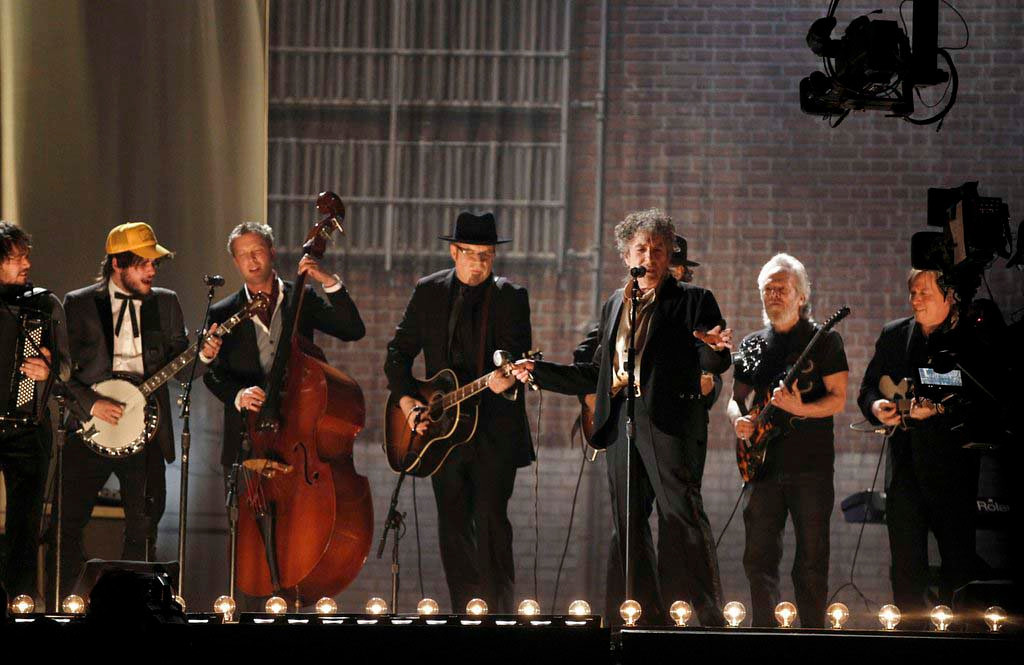. Feb. 2011: Bob Dylan, center, performs with Mumford and Sons and the Avett Brothers at the 53rd annual Grammy Awards in Los Angeles. (AP Photo/Matt Sayles)