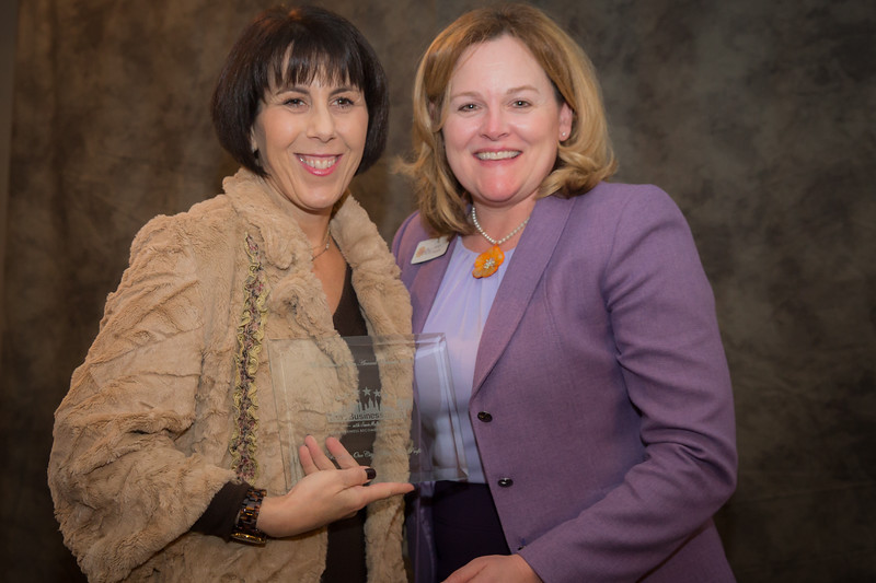 Beth Blacker of Tampa Bay Business Owners presenting Best Non-Profit Award to winner Mindy Murphy The Spring of Tampa Bay