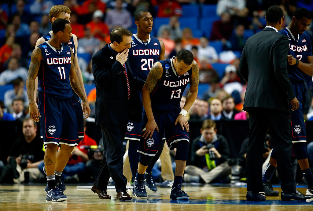 . BUFFALO, NY - MARCH 22:  Shabazz Napier #13 of the Connecticut Huskies leaves the court with a leg injury against the Villanova Wildcats during the third round of the 2014 NCAA Men\'s Basketball Tournament at the First Niagara Center on March 22, 2014 in Buffalo, New York.  (Photo by Jared Wickerham/Getty Images)