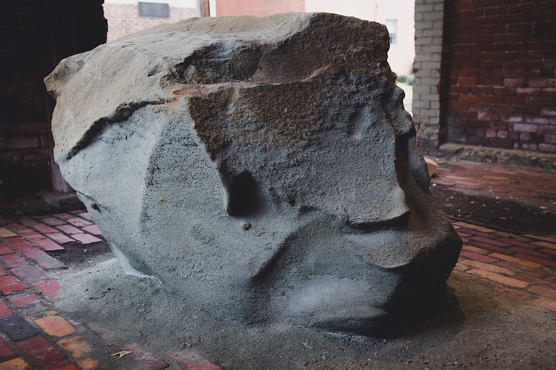 Why this piece of rock sits in an abandoned entryway in Pittsburg is unknown to me.