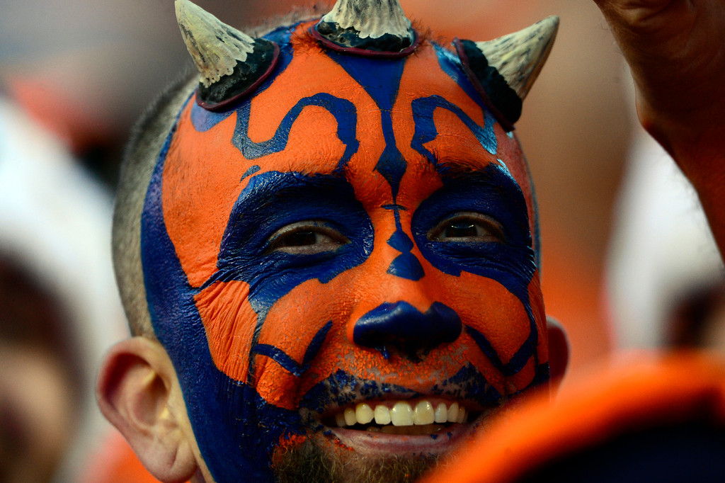 . DENVER, CO - DECEMBER 28: A Broncos fan cheers on the team in the third quarter.  The Denver Broncos played the Oakland Raiders at Sports Authority Field at Mile High in Denver on December, 28 2014. (Photo by Joe Amon/The Denver Post)