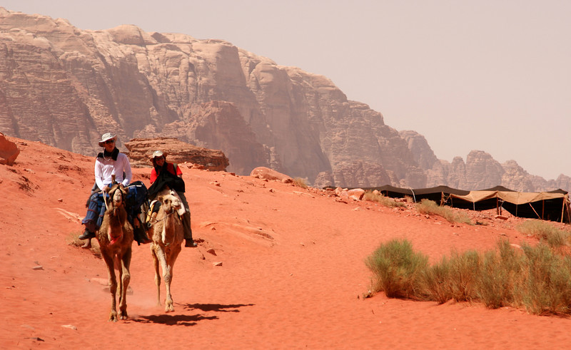 Wadi Rum - Couple on a camel ride into Jebel Khazali.