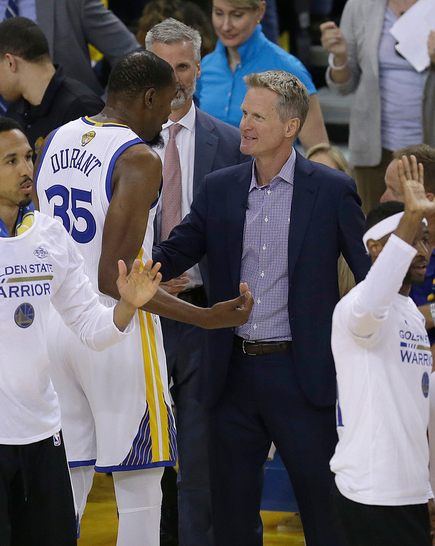 . Golden State Warriors forward Kevin Durant (35) talks with head coach Steve Kerr during the first half of Game 2 of basketball\'s NBA Finals against the Cleveland Cavaliers in Oakland, Calif., Sunday, June 4, 2017. (AP Photo/Ben Margot)