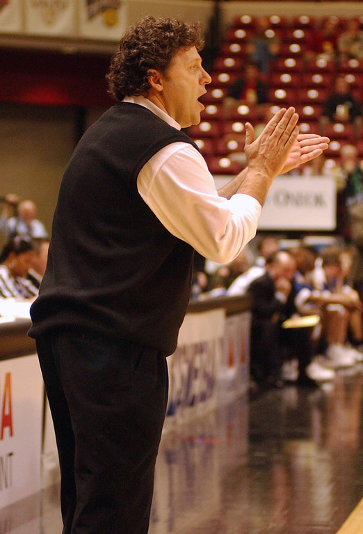 . Oakland University men\'s basketball head coach Greg Kampe cheers on his team against UMKC during second half action, Saturday, March 5, 2005, at the John Q. Hammons Arena in Tulsa, Okla.  Oakland beat UMKC, 67-63, to advance to the second round of the Mid-Continent Conference Basketball Championships.
