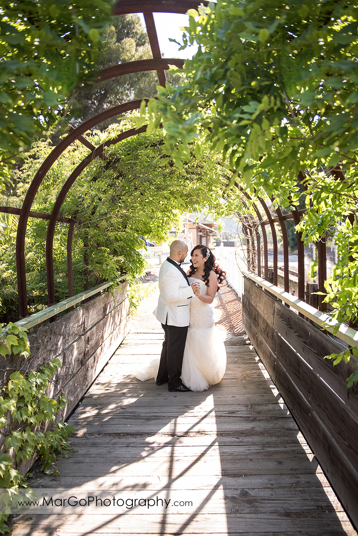 bride and groom dancing in the green tunnel near Sunol's Casa Bella