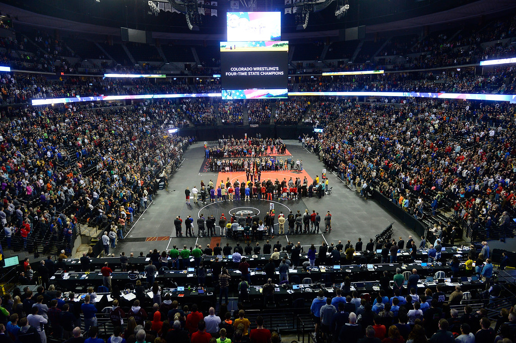 . Wrestlers and coaches stand during the pledge pf allegiance during the Parade of Champions during the finals of the 2016 Colorado Wrestling State Championships at the Pepsi Center on February 20, 2016 in Denver, Colorado. (Photo by Brent Lewis/The Denver Post)