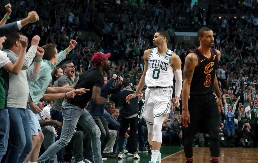 . Boston Celtics forward Jayson Tatum (0) celebrates his basket against the Cleveland Cavaliers with fans during the second half in Game 7 of the NBA basketball Eastern Conference finals, Sunday, May 27, 2018, in Boston. (AP Photo/Elise Amendola)