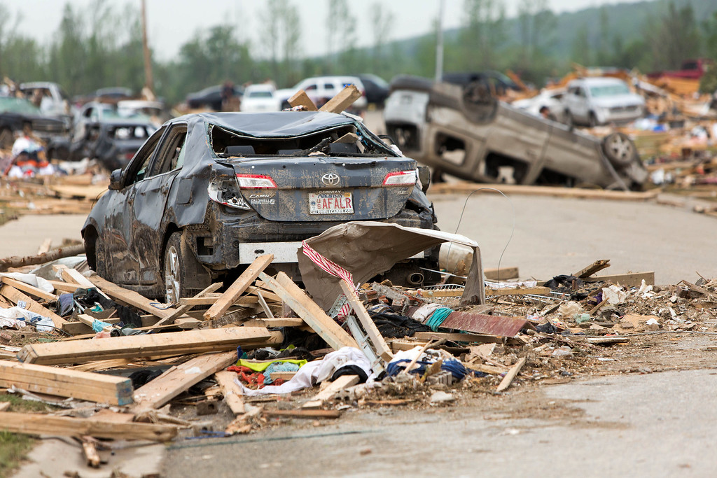 . Piles of mangles cars and destroyed homes sit along Aspen Creek Drive in the Parkwood Neighborhood off Naylor Road in Vilonia, Ark., Monday, April 28, 2014 after a tornado struck the town late Sunday. (AP Photo/Karen E. Segrave)