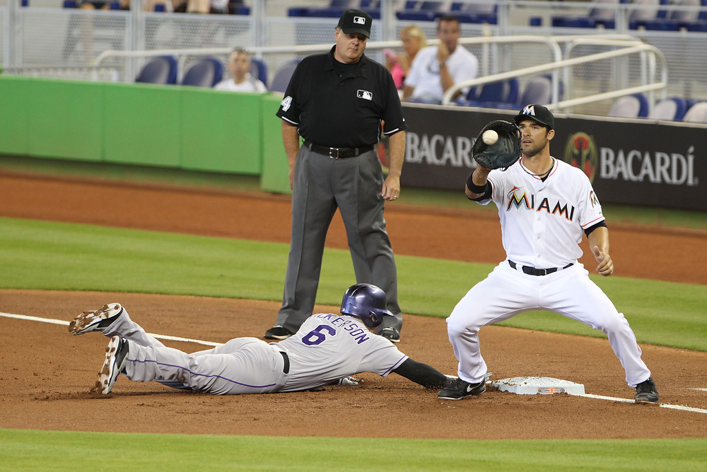 . First baseman Garrett Jones #46 of the Miami Marlins attempts to pick off Corey Dickerson #6 of the Colorado Rockies during the first inning at Marlins Park on April 3, 2014 in Miami, Florida.  (Photo by Marc Serota/Getty Images)